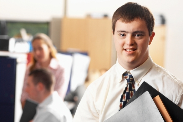 Young man with downs syndrome looking at the camera